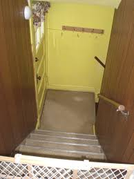 Laying Vinyl Tile Over Linoleum by Peel And Stick The Stairway Saga Continues