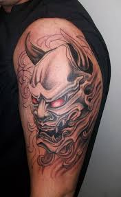 Scary Asian Hannya Mask With Red Eye Tattoo On Shoulder