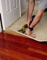 How Does A Carpet Stretcher Work by Installing Carpet Against Hardwood Floors Step By Step With Photos