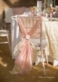 A Limewash Chiavari Chair With A Hand Tied Dusky Pink And ...
