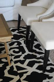 flooring living room design with mid century armchairs