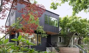 104 Contemporary Cedar Siding Pink House Stained Exterior Conceals A Clean Modern Interior