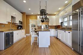 White Country Kitchen With Wood Butcher Block Counters Hanging Pots And Pans Small Breakfast
