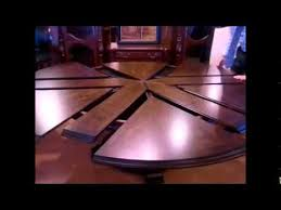 80 round dining table with self storing leaves from mahogany and
