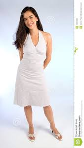 beautiful young lady in a white summer dress stock photography