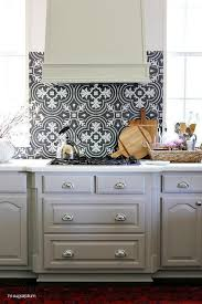 black and white mosaic tile kitchen backsplash with gray kitchen
