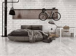 moderne loft style schlafzimmer in wohnung mit einrichtungsgegenständen rundbett und fahrrad hängt an der wand