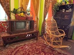 Antique Box TV In Living Room Of Wooden House With Rattan Rocking.. Whosale Rocking Chairs Living Room Fniture Set Of 2 Wood Chair Porch Rocker Indoor Outdoor Hcom Traditional Slat For Patio White Modern Interesting Large With Cushion Festnight Stille Scdinavian Designs Lovely For Nursery Home Antique Box Tv In Living Room Of Wooden House With Rattan Rocking Wooden Chair Next To Table Interior Make Outside Ideas Regarding Deck Garden Backyard