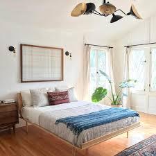 A Minimal Bohemian Bedroom With Big Windows And Bright Hardwood Floors