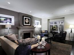 this living room features a gray accent wall situated