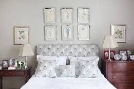 light grey walls gallery wall above bed bedroom ideas