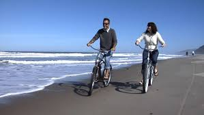 Stock Video Of Couple Riding Bikes On The Beach
