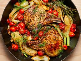 Pan Seared Pork Chops With Roasted Fennel And Tomatoes Image