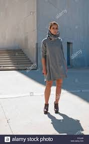young attractive iranian woman wearing stylish clothing against a