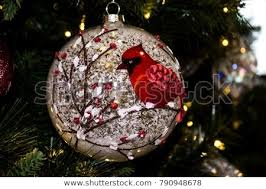 Closeup Of A Christmas Tree Ornament With Red Cardinal