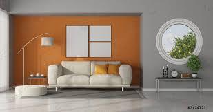 foto auf lager modernes wohnzimmer mit rundem fenster an grauer wand