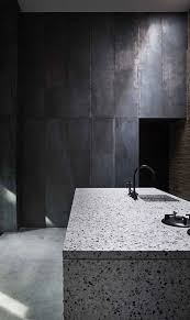 A White Terrazzo Kitchen Island Looks Contrasting In This Moody