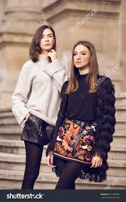 two beautiful fashion models posing outside stock photo 371408986