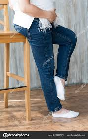 Legs In Jeans On The High Chair Of The Pregnant Girl ...