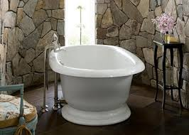 Roll Top In The Middle Of Bathroom With Stone Walls On Tile Floor For Rustic