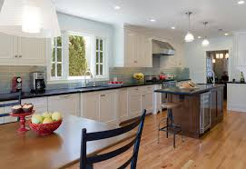blue subway tile kitchen traditional with black counters blue tile