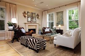 Larger Formal Living Room Incorporating Zebra Print With Two Identical Ottomans Off To The