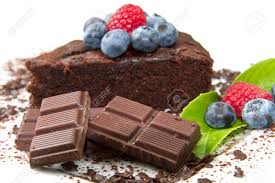 Piece of chocolate cake with fresh berry on white background Stock