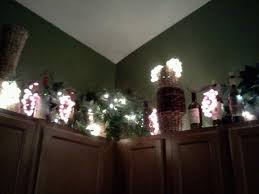 I Took Grape Lights And Empty Wine Bottles Placed Them Above My Kitchen Along With