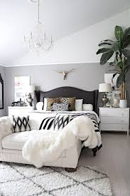 Neutral Bedroom With Crystal Chandelier Button Tufted Chaise Black And White Accents Leather