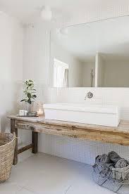antique harvest table as vanity in bathroom bad