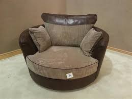 Swivel Cuddle Chairs Uk by Kudos Brown And Coffee Fabric Swivel Cuddle Chair Furniture