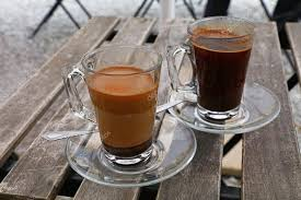 Two Turkish Coffee Glass Cups Black And With Milk Stock Photo