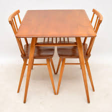 1960's Vintage Ercol Elm Dining Table & Chairs | Retrospective ... 1960s Ding Room Table Chairs Places Set For Four Fringed Stanley Fniture Ding Chairs By Paul Browning Set Of 6 For Proper Old Room Tempting Large Chair Pads As Well Broyhill Newly Restored Vintage Aptdeco Four Rosewood Domino Stildomus Italy Ercol Ding Room Table And 4 Chairs In Cgleton Cheshire Teak Table Greaves Thomas Mid Century Duck Egg Green Bernhardt Modern Walnut Brass Lantern Antiques Niels Otto Mller Two Model No 85 Teak