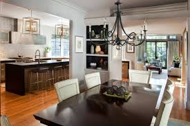 Dining Room Rectangle Black Wooden Table With White Chairs Having High Back Placed On The