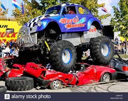 Monster Trucks Drive Over Old Cars At The Monster Truck Show In ...