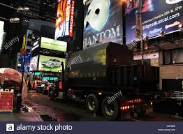 100 Action Truck Night Shot Green Garbage Truck Below Theatre Billboards Wet