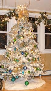 65 Flocked Alaskan Christmas Tree With Warm White Lights On