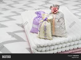 Purple Decorative Towel Sets by Three Lavender Scent Pouches On Towels Scented Sachets On Bedroom