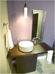 Bathroom Wall Cabinet With Towel Bar White by A Chandelier Above The Luminous And Round White Sink And Plain