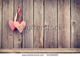 Two Valentines Day Hearts On Rustic Wooden Wall With Copy Space Toned 345169520
