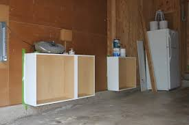 unfinished garage makeover design with wood wall panels cover plus
