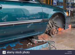 100 Car Elevator Garage Repairing A Wheel Of Car On Lift Elevator In Garage Stock Photo