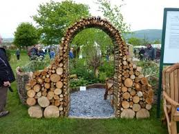 Garden Arch Made Of Short Logs I Love The Idea Using Wood For A Fireplace Into Decorative Feature