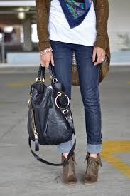 skinny rolled up jeans ankle boots white tshirt scarf olive