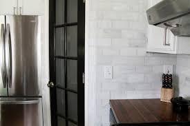 Tiles For Backsplash In Bathroom by That Hampton Carrara Marble Backsplash Done Zo Chris Loves Julia