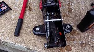how to add or change hydraulic fluid on floor jack youtube