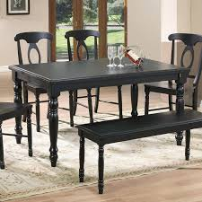 This Black Toned Hardwood Table Features Carved Arrow Foot Legs And A Two Tiered Surface