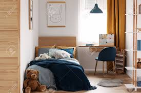 Desk, Chair And Single Bed With Blue Bedding In Cozy Bedroom.. Desk Chair And Single Bed With Blue Bedding In Cozy Bedroom Lngfjll Office Gunnared Beige Black Bedroom Hot Item Ergonomic Home Fniture Comfotable Chairs Wheels Basketball Hoop Chair Bedside Tables Rooms White Bedrooms And Small Hotel Office Table Desk Lamp Wooden Work In Stool Space Image Makeup Folding Table Marvellous Computer Set 112 Dollhouse Miniature 6pcs Wood Eu Student Main Sowing Backrest Solo Stores Seating Reading 40 Luxury Modern Adjustable Height