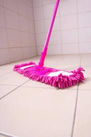 pink mop cleaning tile floor in bathroom stock photo image 35050244