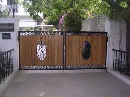 Fetching-house-iron-gate-design-brown-wooden-panels-swirl-shape ... Front Doors Gorgeous Door Gate Design For Modern Home Plan Of Iron Fence Best Tremendous Rod Gates 12538 Exterior Awesome Entrance And Decoration Using Light Clever Designs Homes Homesfeed Hot Simple In Kerala Addition To Firstrate 1000 Ideas Stesyllabus Concrete Driveway Automatic Openers With